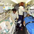 Earthquake survivors Azra, a 14-day-old baby girl, and her mother Semiha Karaduman (right) lie in...