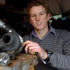 East Otago High School pupil Lachlan Matchett with a jet engine he built in his parents' garden...