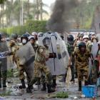 ecurity forces throw stones back at protesters near Egypt's Defence Ministry earlier this month....