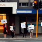 Educators gather outside the office of National list MP Michael Woodhouse in an early morning...