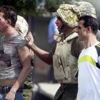 Egyptian army officers arrest a suspected demonstrator. REUTERS/Amr Abdallah Dalsh