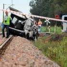 Emergency services investigate the wreck of a minibus at a crash site in Bratoszewice near Lodz,...