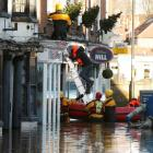 Emergency services rescue a group of people from a property in Tadcaster, northern England....