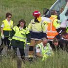 Emergency services staff tend to the injured. Photo Stephen Parker via NZ Herald