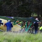 Emergency services surround a plane which suffered a power failure near Waldronville last night....
