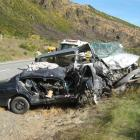 Emergency services tend to the victims of a head-on crash in the Lindis Pass yesterday. Photo...