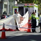 Emergency services work at the scene of a fatal crash in Cumberland St, outside Dunedin Hospital,...