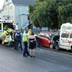 Emergency services work at the scene of a two-vehicle crash on upper Stuart St, Dunedin, on...