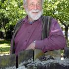 Emeritus Prof Sir Alan Mark relaxes outside his University of Otago office. Photo by Gregor...