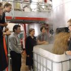Emerson Brewing Co Ltd production manager Chris O'Leary shows Kavanagh College's food science...