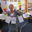 Emily Findlay (5), Phillipa Wilson and Jackson Vallance (5) display artworks by New Zealand...