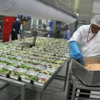 Emirates Flight Catering staff prepare some of the 115,000 meals they produce each day. Photo by...