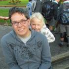 Emjai Welsh (5), of Oamaru,   peeks over the shoulder of Waitaki Boys' High School  pupil Matthew...
