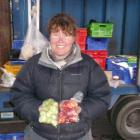 Employee Nicola Grigg sells Grown's Brussels sprouts and yams at the Christchurch Farmers Market...
