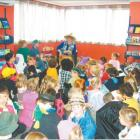 Story time: Arabella Storyteller (Valmai Redhead) prepares to read a story to the children in...