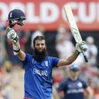 England batsman Moeen Ali celebrates 100 runs during their Cricket World Cup match against...