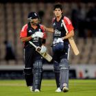 England captain Alastair Cook (R) and batsman Samit Patel leave the field after defeating India...