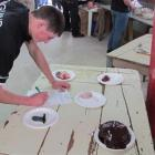 England representative Alastair Graham (21) attempts to classify sheep organs at the World Youth...
