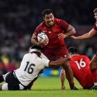 England's Billy Vunipola crashes through the Fiji defence on his way to the tryline. Photo Reuters