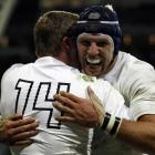 England's Chris Ashton celebrates with teammate James Haskell after scoring a try against Romania...
