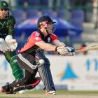 England's Eoin Morgan, right, is dismissed lbw during the one-day match against Pakistan at the...