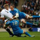 England's Geoff Parling (L) is tackled by Italy's Sergio Parisse (R) and Gonzalo Garcia during...