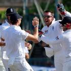 England's Graeme (2nd R) Swann celebrates with teammates as he takes the wicket of Sri Lanka's...