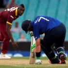 England's Ian Bell ducks a bouncer from West Indies bowler Andre Russell. REUTERS/David Gray