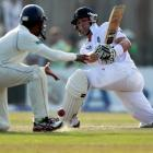 England's Jonathan Trott (R) plays a shot during the third day of the first test against Sri...