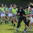 England's Manu Tuilagi practices with students from Otago Boys High School in Dunedin yesterday....