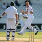 England's Stuart Broad (R) celebrates after dismissing South Africa's Jacques Kallis during the...