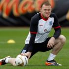 England's Wayne Rooney attends a team training session in London Colney, north of London, earlier...