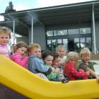 Enjoying the facilities at the newly opened Clutha Valley Playcentre yesterday are (from left)...