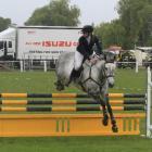 Erin Milner, of Dunedin, on Glenbrooke Jordie Girl, competes in the showjumping event.