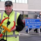 Peter Lunn, of Dunedin International Airport, holds a clamp which will be used to stop people...
