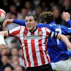 Everton's Nikica Jelavic (R) challenges Sunderland's John O'Shea during their FA Cup match in...