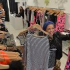 Evolution Clothing area manager Nikki Webster, of Mount Maunganui, prepares the company's new...