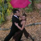 Fabio and Ana Robles, Australian tango dancers, dance in the rain in Wanaka yesterday. Photo by...