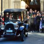 Family and friends pay their last respects to Dame Dorothy Fraser  yesterday as a 1926 Chrysler...
