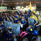 Fans gather at Dunedin Airport to welcome the victorious Otago rugby team and the Ranfurly Shield...