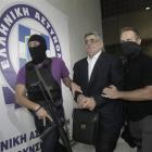 Far-right Golden Dawn party leader Nikos Mihaloliakos (centre) is escorted by anti-terrorism...