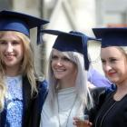 Fashion design graduates (from left) Margot Rieder, Jojo Ross and Tara Young are all smiles after...