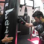 Fight Science Gym owner Braden Lee (left) holds a punch bag while head trainer Stewart Mitchell...