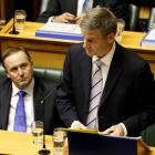 Finance Minister Bill English reads his 2012 Budget in the House today. Photo NZ Herald