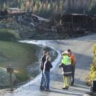 Rata St homeowners Ian and Suzanne Nichol, of Outram, discuss the fire which razed their home...