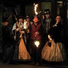 Fire-stick juggler James East welcomes steampunk ball-goers (from left) Fiona Rutland, from...