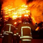 Firefighters battle a blaze at a seven-storey apartment complex under construction in Los Angeles...