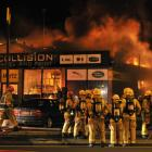 Firefighters converge at last night's blaze at Bodyline Collision Panel and Paint in Wharf St,...