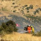 Firefighters dampen hotspots after a fire near Ettrick. Photo by Paul Mooney.