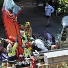 Firefighters free the occupants of a Fifa vehicle, which was involved in a collision with a truck...